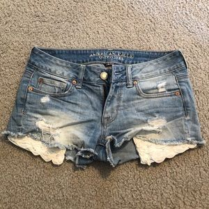 Light wash jean shorts.